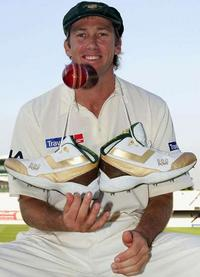 McGrath Changes Cricket Shoes after Taking a Wicket